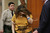 Anna Ayala hides her face as she enters a court room Thursday July 28, 2005 inside Santa Clara County superior court in San Jose.  Ayala and her husband, Jaime Plascencia, who also appeared in the court are facing charges with grand theft related to the infamous 