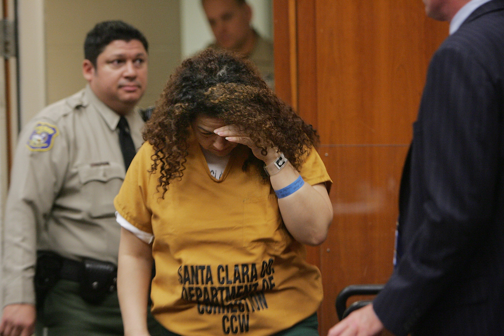 Description of . Anna Ayala hides her face as she enters a court room Thursday July 28, 2005 inside Santa Clara County superior court in San Jose.  Ayala and her husband, Jaime Plascencia, who also appeared in the court are facing charges with grand theft related to the infamous