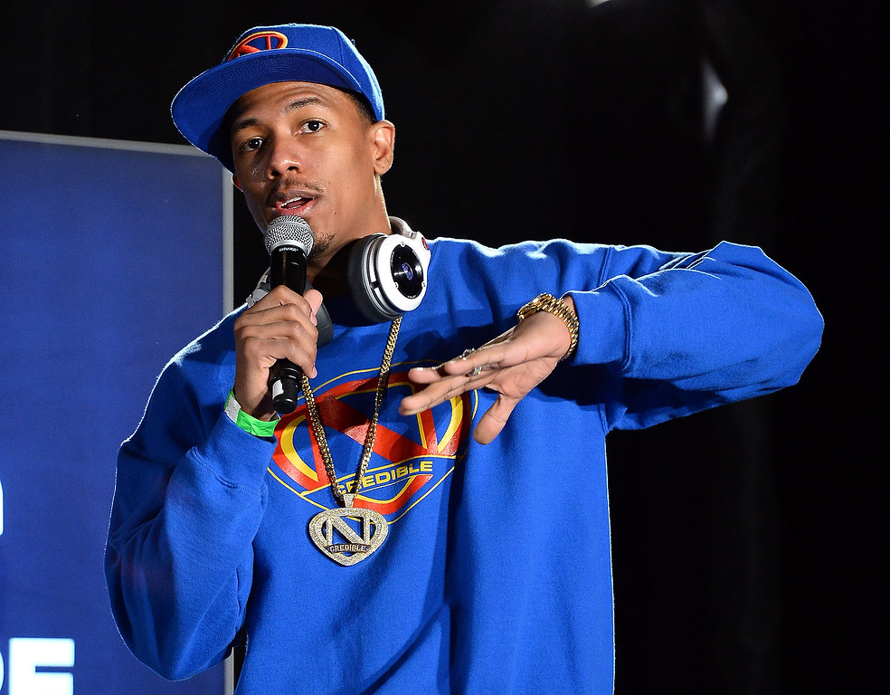 Description of . Actor/media personality Nick Cannon speaks at a press event for Monster Inc. at the Mandalay Bay Convention Center for the 2014 International CES on January 6, 2014 in Las Vegas, Nevada. (Ethan Miller/Getty Images)