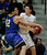 Serra's Matt Jajeh reaches for the ball held by Mitty's John Paul Rindfleisch in the first quarter during the CCS Open Division boys basketball finals at Santa Clara University in Santa Clara, Calif. on Saturday, March 2, 2013. The Archbishop Mitty Monarchs played the Serra Padres. (Jim Gensheimer/Staff)