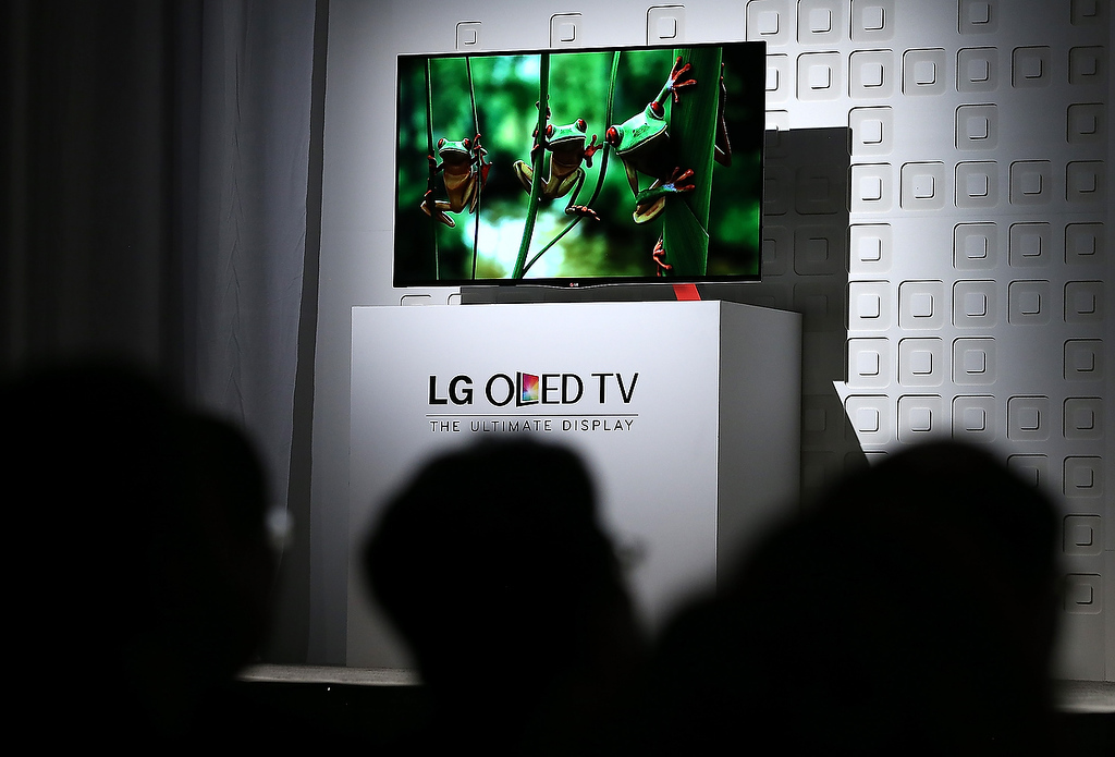 Description of . The new LG OLED TV is displayed during an LG press conference during the 2013 International CES at the Mandalay Bay Convention Center on January 7, 2013 in Las Vegas, Nevada. (Photo by Justin Sullivan/Getty Images)