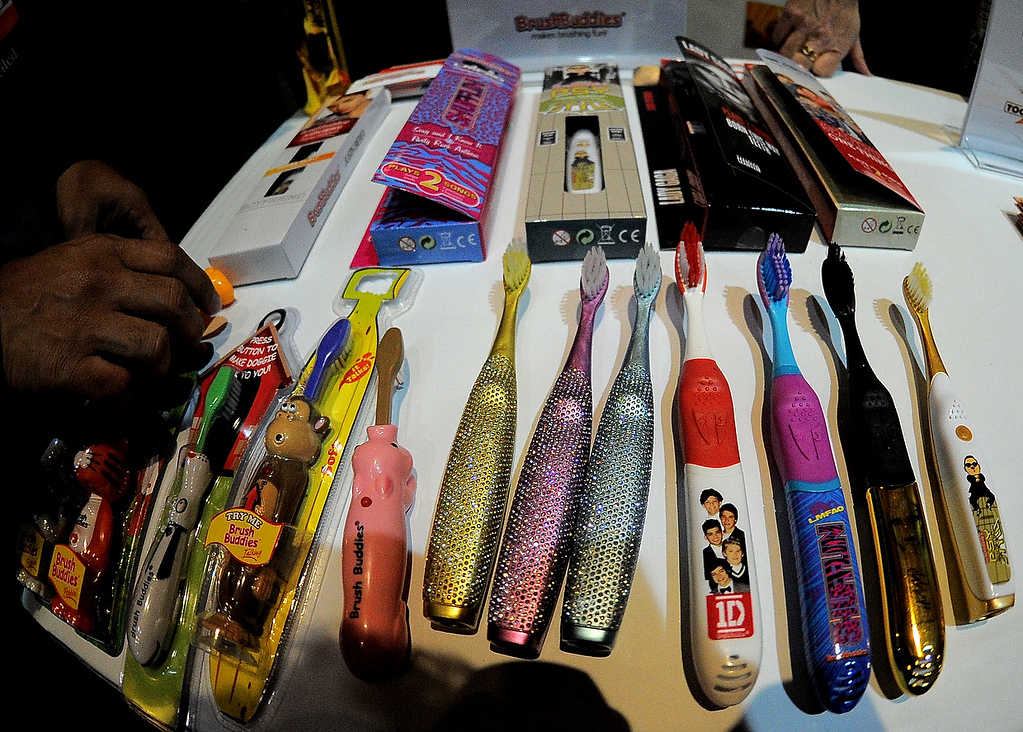 Description of . Brushbuddies dislays talking singing and popping-up tooth brushes during the opening event \'\'CES Unveiled\'\'  during the  International Consumer Electronics Show (CES) in Mandalay Bay Hotel resort on January 6, 2013 in Las Vegas, Nevada. (JOE KLAMAR/AFP/Getty Images)