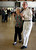 Betty Beebe, left, and Bille Andersen, both of Livermore, dance to the music of the Cool Tones with lead singer, Kathy Blackburn, at the Pleasanton Senior Center's 20th anniversary celebration tea dance in Pleasanton, Calif. on Sunday, March 3, 2013.  (Jim Stevens/Staff)