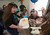 Kristi Ouimet, left, brings her son Matthew, 2, a cupcake as she celebrates his birthday with family and friends at their home in Antioch, Calif., on Sunday, Feb. 10, 2013. To the right is her son Patrick, 7, daughter Molly, 10, and husband Kelly Ouimet. Matthew, who suffers from primary hyperoxaluria type 1, a rare liver disease, turned two on Feb. 11. He undergoes dialysis six times a week at the UCSF Medical Center in San Francisco, and is on the transplant list awaiting a liver and kidneys. (Jane Tyska/Staff)