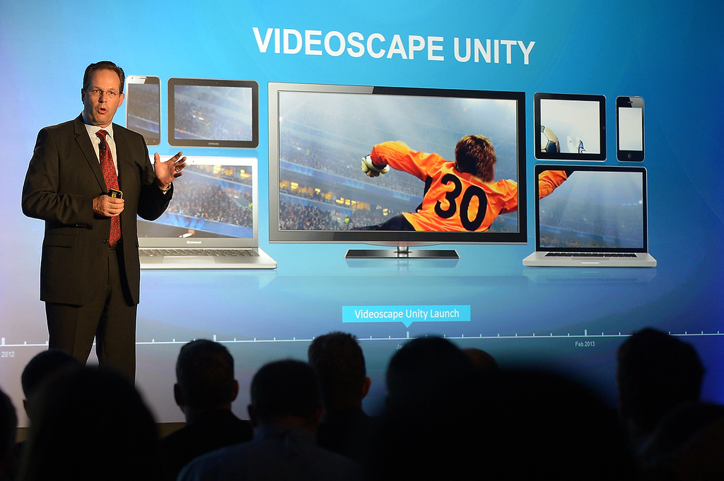 Description of . Marthin DeBeer, senior vice-president for video and collaboration group, introduces Videoscape Unity at the 2013 International Consumer Electronics Show in Las Vegas on January 7, 2013. (JOE KLAMAR/AFP/Getty Images)