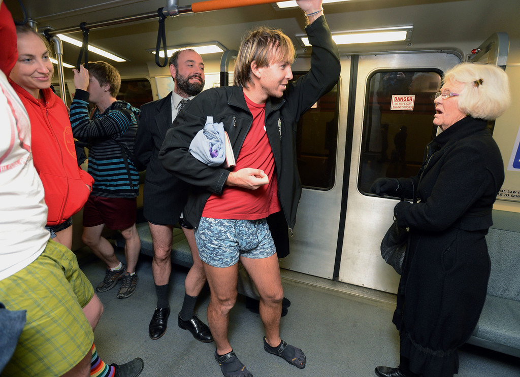 Description of . All bundled up Sue Ferro of Pleasant Hill asks about BART riders not wearing pants as the west bound BART train heads to the Civc Center station during the