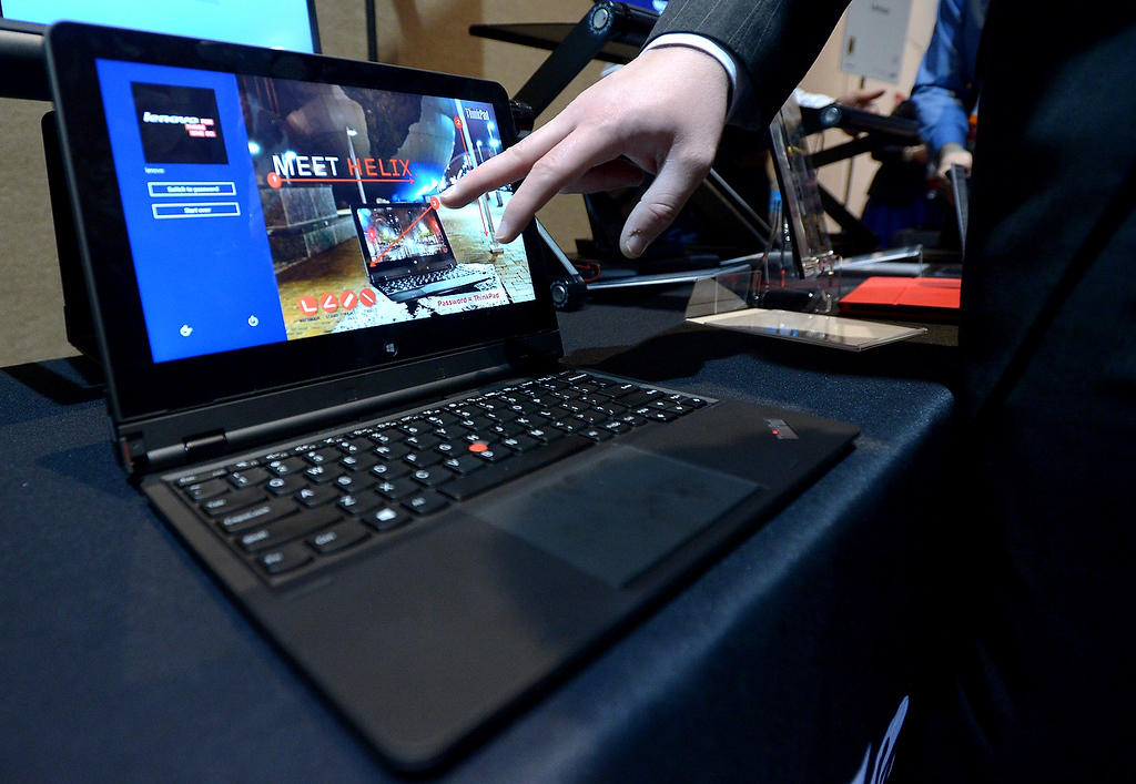 Description of . Lenovo introduces their new tablet/laptop Thinkpad Helix during the opening event \'\'CES Unveiled\'\'  during the  International Consumer Electronics Show (CES) in Mandalay Bay Hotel resort on January 06, 2013 in Las Vegas, Nevada. (JOE KLAMAR/AFP/Getty Images)