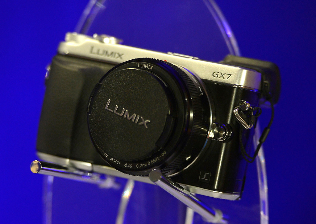 Description of . The new Panasonic Lumix GX7 is on display during the Panasonic news conference at the 2014 International Consumer Electronics Show Monday, Jan. 6, 2014, in Las Vegas. (AP Photo/Jack Dempsey)