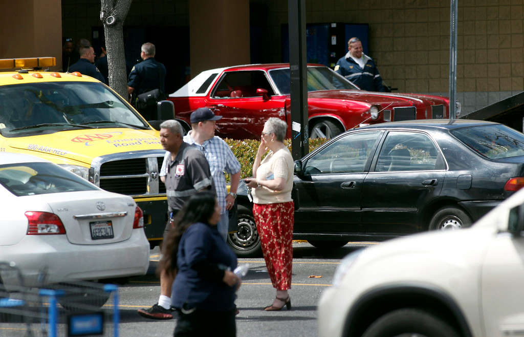 Description of . Sharon Kaye, center, had her car struck by the red Cutlass (back) that drove into a Walmart store on Story Road in San Jose, Calif., Sunday, March 31, 2013. The school teacher said the driver came fast and actually had to back up once to get a better angle at the front door before crashing through it. (Karl Mondon/Staff)