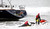 Rescuers attempt to grab a man off the back of the 82-foot-long sailboat, the Darling, stuck in the surf off Linda Mar Beach in Pacifica, Calif., Monday morning March 4, 2013. The boat had been reported stolen from a Sausalito marina earlier. The three people aboard were all rescued and arrested. (Karl Mondon Photo)