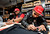 Rapper E-40, left, and Giants Reliever Sergio Romo sign autographs at a Marines Corps Reserve Toys For Tots event held at Kinder's Meats and Deli on Wednesday, Dec. 12,  2012, in Pleasant Hill, Calif. (Susan Tripp Pollard/Staff)