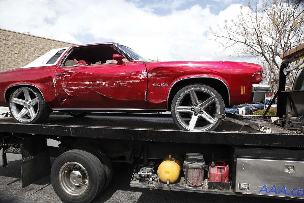 Description of . A red Cutlass Salon is towed away after crashing into a Walmart store on Story Road in San Jose, Calif., Sunday afternoon, March 31, 2013.  (Karl Mondon/Staff)