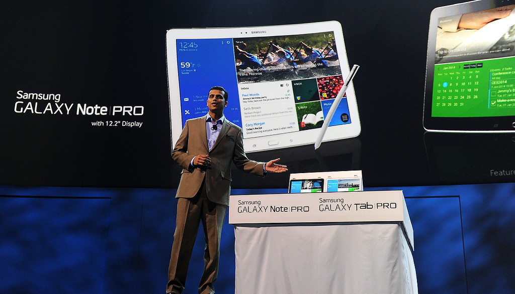Description of . Samsung Telecommunications America Vice President Nanda Ramachandran speaks at the Samsung press event at the Mandalay Bay Convention Center for the 2014 International CES on January 6, 2014 in Las Vegas, Nevada. (ROBYN BECK/AFP/Getty Images)