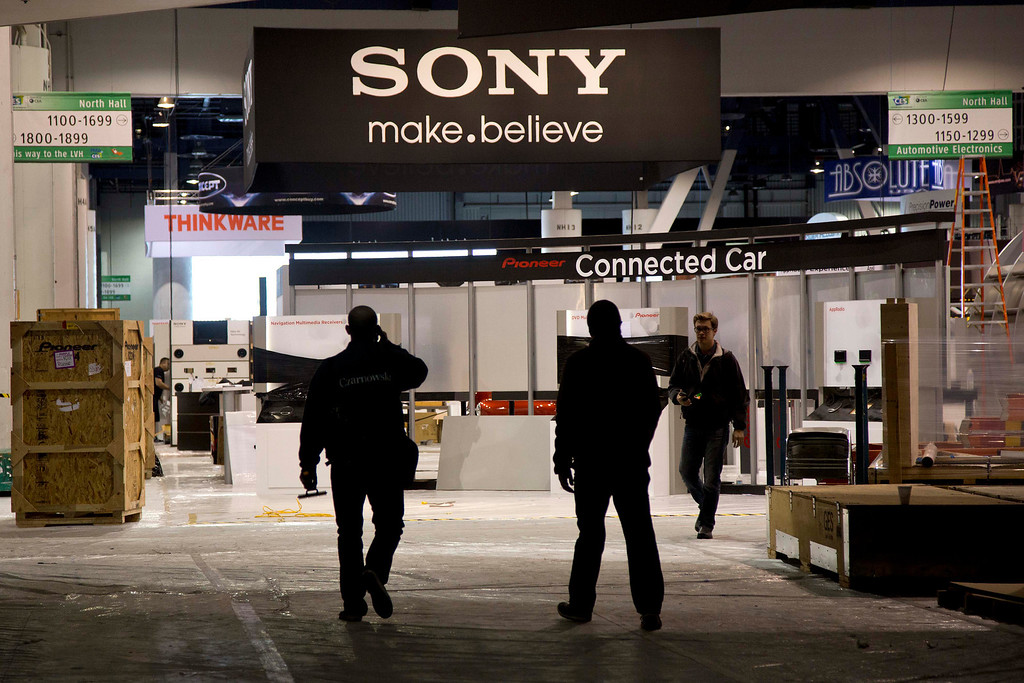 Description of . Las Vegas Convention Center exhibit contractors enter the North Hall while setting up spaces for the International Consumer Electronics Show, Sunday, Jan. 6, 2013, in Las Vegas. (AP Photo/Julie Jacobson)