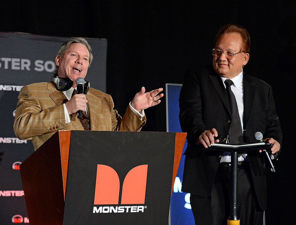 Description of . World Poker Tour commentator Mike Sexton (L) and Monster Inc. Founder and CEO Noel Lee speak during a press event at the Mandalay Bay Convention Center for the 2014 International CES on January 6, 2014 in Las Vegas, Nevada. (Ethan Miller/Getty Images)