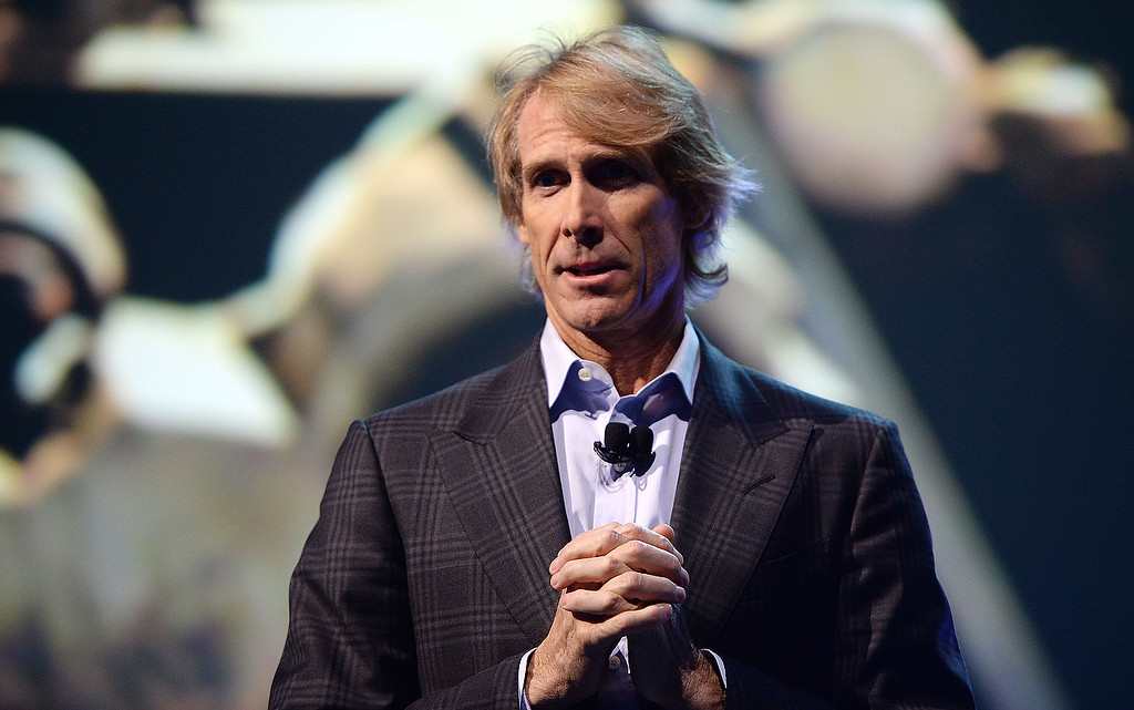 Description of . Movie director Michael Bay speaks at the Samsung press event at the Mandalay Bay Convention Center for the 2014 International CES on January 6, 2014 in Las Vegas, Nevada. (ROBYN BECK/AFP/Getty Images)