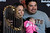 Rigo and Ericka Gonzales, of Richmond, hold two-month-old daughter Isabel as they pose with the World Series Trophy as it makes a stop at the Richmond Memorial Auditorium in Richmond, Calif. on Monday, Jan. 14, 2013.  (Kristopher Skinner/Staff)