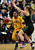 Bishop O'Dowd High's Aisia Robertson (15) left, looks for a shot as Miramonte High's Kaitlin Fenn (10) blocks in the first period of their Division III North Coast Section basketball game in Dublin, Calif., on Saturday, March 2, 2013. Bishop O'Dowd High went on to win the game 77-48. (Doug Duran/Staff)
