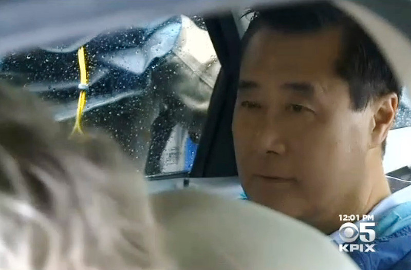 State Sen. Leland Yee,  sits in the back of a law enforcement vehicle followin his arrest Wednesday, March 26, 2014, in San Francisco, Calif., as seen in this video frame grab. Yee has been charged wtih conspiring to traffic in firearms and public corruption.  (KPIX5)