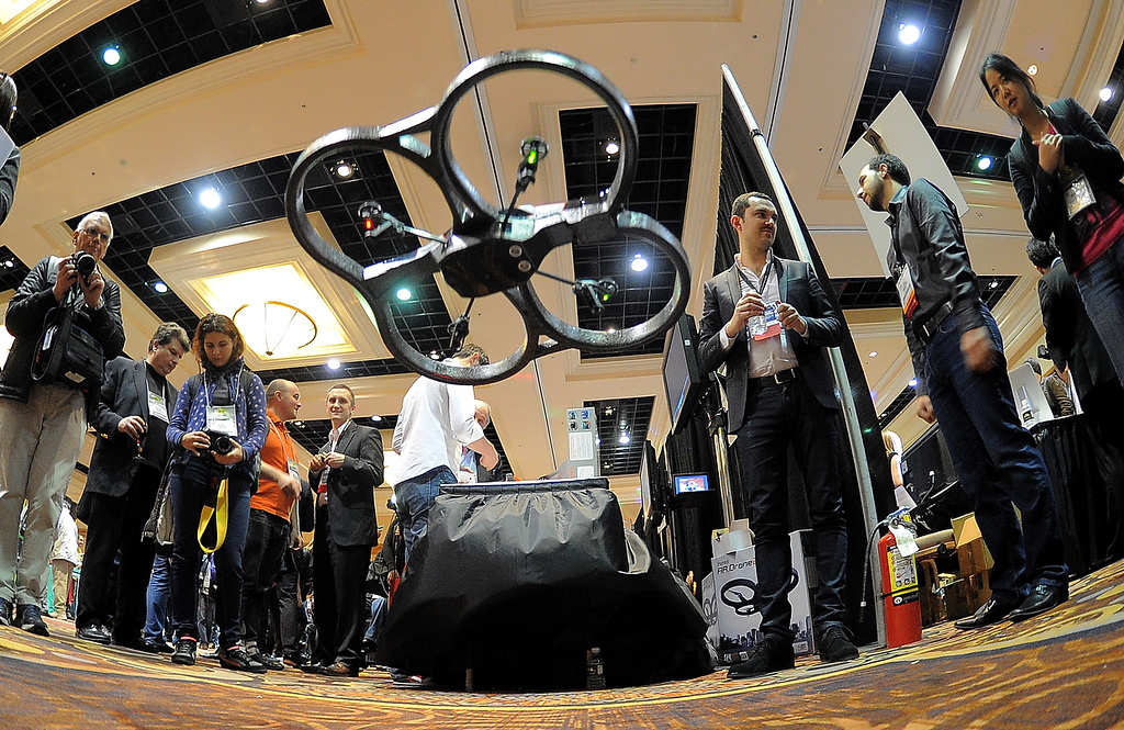 Description of . French Parrot introduces their automatic 4 rotor flying drones during the opening event \'\'CES Unveiled\'\'  during the  International Consumer Electronics Show (CES) in Mandalay Bay Hotel resort on January 06, 2013 in Las Vegas, Nevada. (JOE KLAMAR/AFP/Getty Images)