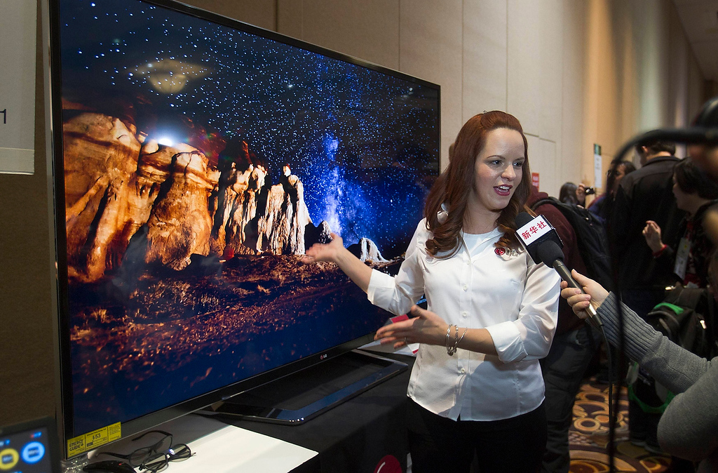 Description of . Nitza Martinez shows off an 84-inch Ultra HD LED television by LG Electronics at the opening press event of the Consumer Electronics Show (CES) in Las Vegas January 6, 2013. The retail price for the television is $19,999.99. (REUTERS/Steve Marcus)