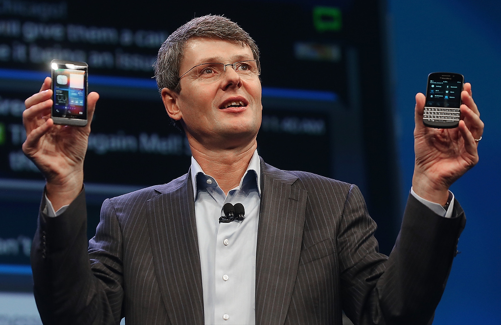 Description of . BlackBerry Chief Executive Officer Thorsten Heins displays the new Blackberry 10 smartphones at the BlackBerry 10 launch event by Research in Motion at Pier 36 in Manhattan on January 30, 2013 in New York City. (Photo by Mario Tama/Getty Images)