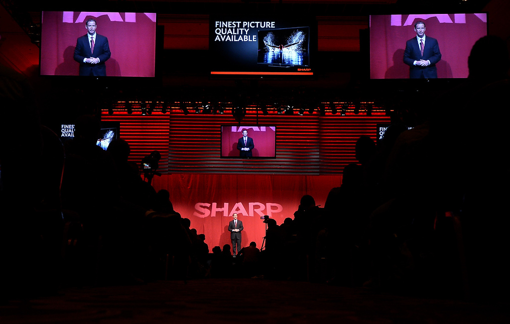 Description of . John Harrington from Sharp Electronics Marketing of America, speaks at the 2013 International Consumer Electronics Show in Las Vegas, Nevada, on January 7 , 2013. (JOE KLAMAR/AFP/Getty Images)