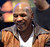 Retired American proffessional boxer Mike Tyson signs autographs at SMS Audio booth at the 2013 International CES at the Las Vegas Convention Center on January 9, 2013 in Las Vegas, Nevada. (JOE KLAMAR/AFP/Getty Images)