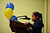 Sankofa Academy second-grader Graciela Giraldo steps to the microphone as she participates in the school's second annual spelling bee in Oakland, Calif. on Wednesday, Jan. 23, 2013. Graciela would go on to be the top finishing second-grader. (Kristopher Skinner/Staff)