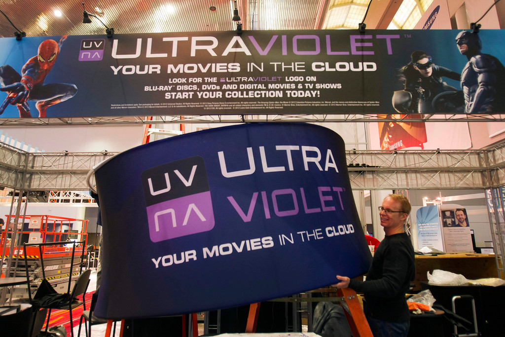 Description of . Workers prepare an UltraViolet booth in the lobby of the Las Vegas Convention Center for the International CES in Las Vegas, Nev., on Jan. 5, 2013. UltraViolet is a cloud-based licensing system that allows users to stream videos to multiple devices. (REUTERS/Steve Marcus)