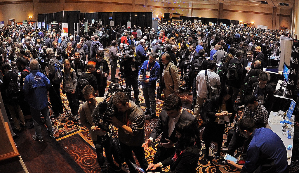 Description of . Journalists and visitors arrive to pre opening event \'\'CES Unveiled\'\' event during the International Consumer Electronics Show (CES) in Mandalay Bay Hotel resort on January 06, 2013 in Las Vegas, Nevada. (JOE KLAMAR/AFP/Getty Images)