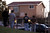 People stand outside of a house as San Jose Police Officers investigate a double homicide at a home on the 1800 block of Bermuda Way in San Jose, Calif., on Thursday, Feb. 14, 2013.  (Nhat V. Meyer/Staff)
