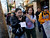 Rosie Mendoza, center, and Nayeli Cruz, far right, help lead a march while walking south on S. 2nd St. during an