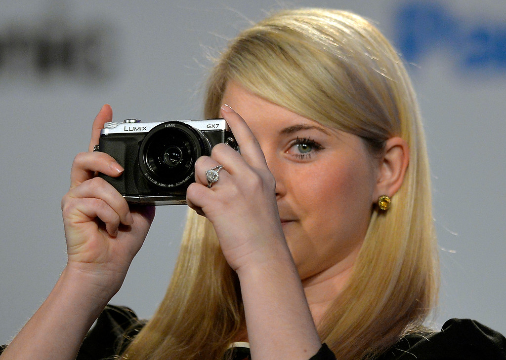 Description of . The new Panasonic Lumix GX7 is shown during the Panasonic news conference at the 2014 International Consumer Electronics Show Monday, Jan. 6, 2014, in Las Vegas. (AP Photo/Jack Dempsey)
