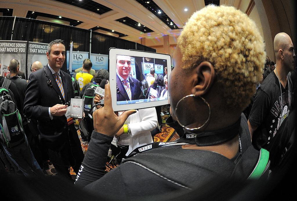 Description of . Journalists make interview with an iPad during the opening event \'\'CES Unveiled\'\'  during the International Consumer Electronics Show (CES) in Mandalay Bay Hotel resort on January 06, 2013 in Las Vegas, Nevada. (JOE KLAMAR/AFP/Getty Images)