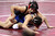 James Logan's Jacob Macalolooy, top, wrestles Beaumont's Terrill Sidener in a 138-pound third round match during the California Interscholastic Federation wrestling championships in Bakersfield, Calif., on Friday, March 1, 2013. Macalolooy would go onto win. (Anda Chu/Staff)