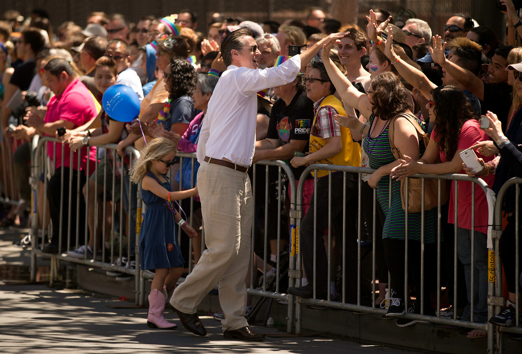 . Calif. Lt. Gov. and former San Francisco Mayor Gavin Newsom, center, greets the crowd at the 44th annual LGBT Pride parade, Sunday, June 29, 2014 on Market Street in San Francisco. (D. Ross Cameron/Bay Area News Group)