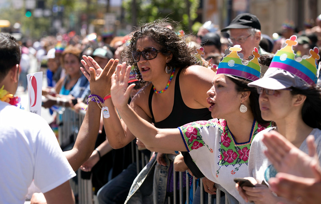 . Spectators high five the marchers at the 44th annual San Francisco Pride Parade, Sunday, June 29, 2014 on Market Street in San Francisco. (D. Ross Cameron/Bay Area News Group)