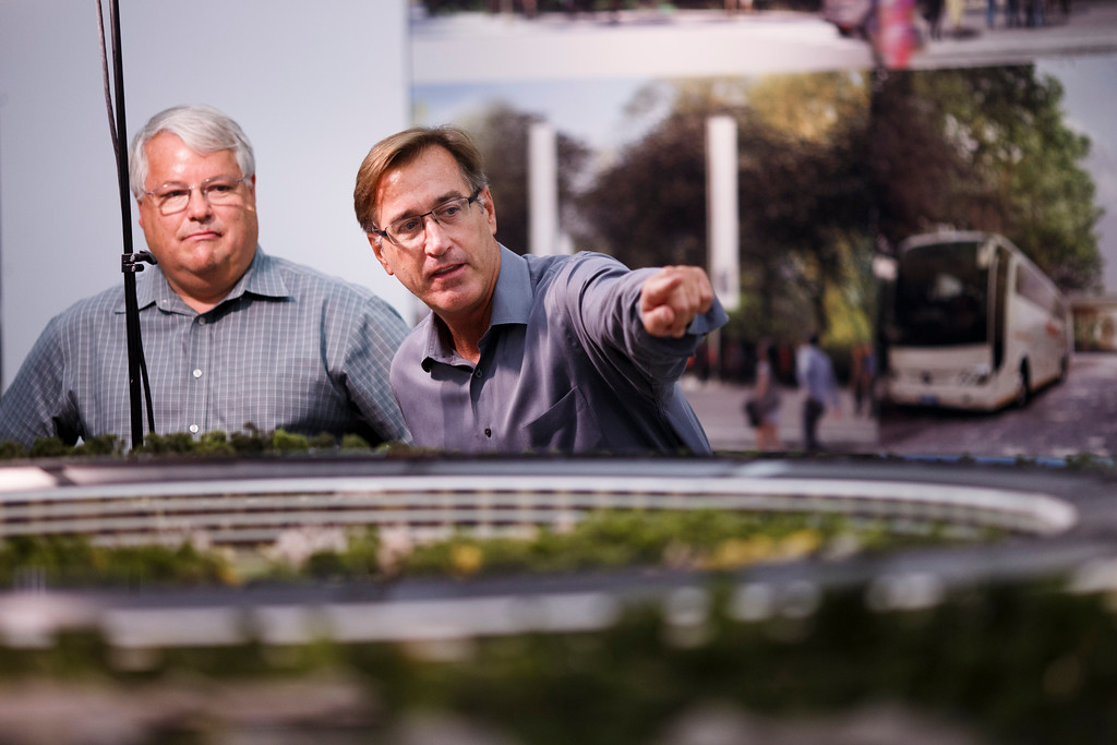 . Apple\'s Chief Financial Officer Peter Oppenheimer, left, and Senior Director of Real Estate and Facilities at Apple, Dan Whisenhunt show this newspaper a model of Apple\'s proposed new campus on Oct. 10, 2013 at Apple\'s office located at the proposed new campus site in Cupertino. (Dai Sugano/Bay Area News Group)