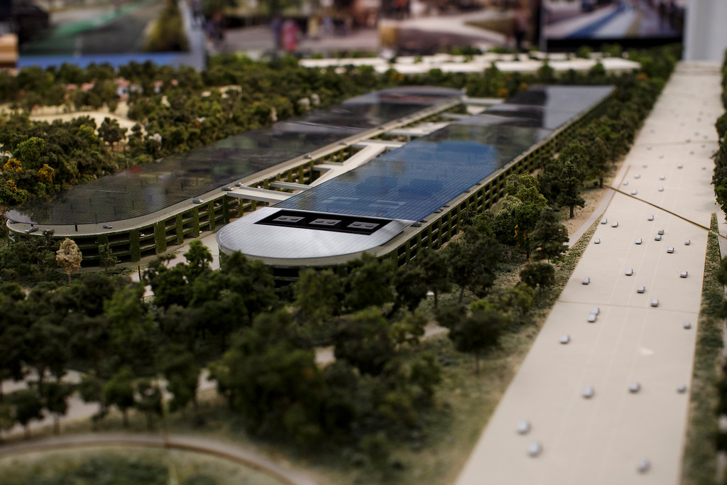 . A model of Apple\'s proposed new campus includes parking structures by Interstate 280. The plan will go up for a final vote before the Cupertino City Council on Oct. 15. The model was photographed at Apple\'s office located at the proposed new campus site on Oct. 10, 2013 in Cupertino. (Dai Sugano/Bay Area News Group)