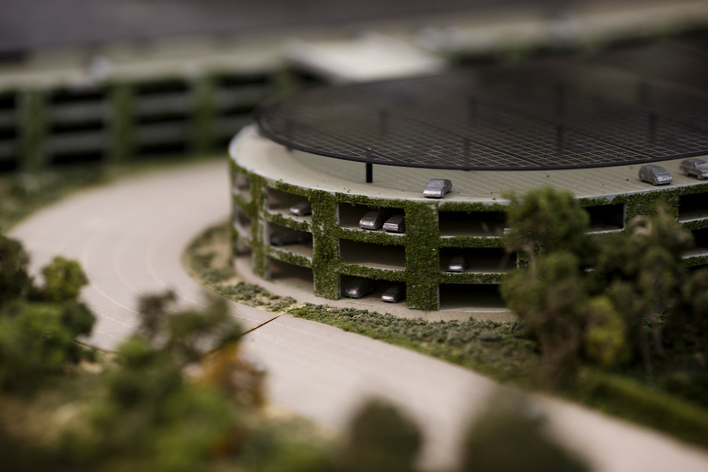 . A model of Apple\'s proposed new campus includes parking structures with solar panels. The plan will go up for a final vote before the Cupertino City Council on Oct. 15. The model was photographed at Apple\'s office located at the proposed new campus site on Oct. 10, 2013 in Cupertino. (Dai Sugano/Bay Area News Group)