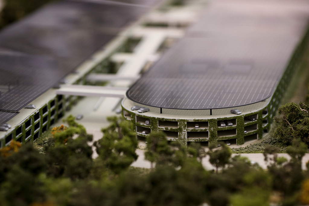 . A model of Apple\'s proposed new campus includes parking structures with solar panels. The plan will go up for a final vote before the Cupertino City Council on Oct. 15. The rendering was photographed at Apple\'s office located at the proposed new campus site on Oct. 10, 2013 in Cupertino. (Dai Sugano/Bay Area News Group)