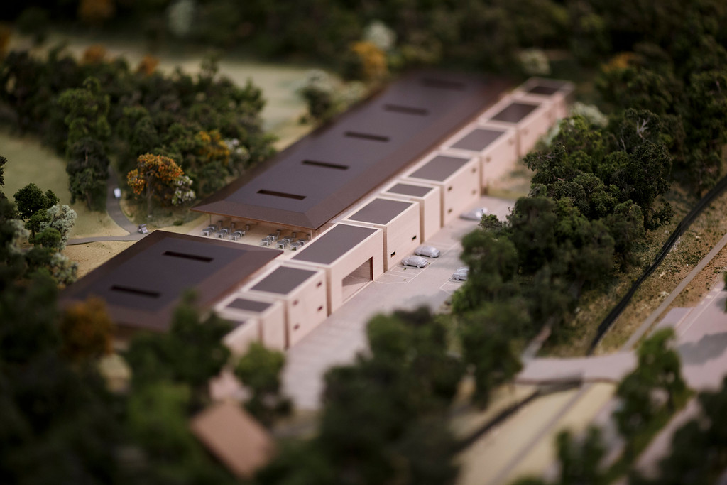 . A model of Apple\'s proposed new campus includes a fitness and wellness center. The plan will go up for a final vote before the Cupertino City Council on Oct. 15. The model was photographed at Apple\'s office located at the proposed new campus site on Oct. 10, 2013 in Cupertino. (Dai Sugano/Bay Area News Group)