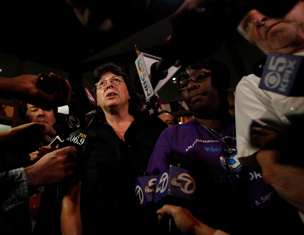 . Roxanne Sanchez, president of SEIU 1021, left, talks about the action Gov. Jerry Brown took to avert a BART strike outside of the Caltrans offices in Oakland, Calif. on Sunday, Aug. 4, 2013.  At center is Antonette Bryant, president of ATU Local 1555 and George Popyack, far right, lead negotiator of AFSCME 3993.  Governor Brown appointed a board to investigate the contract dispute between BART and its unions which ended the threat of strike for seven days.  (Nhat V. Meyer/Bay Area News Group)