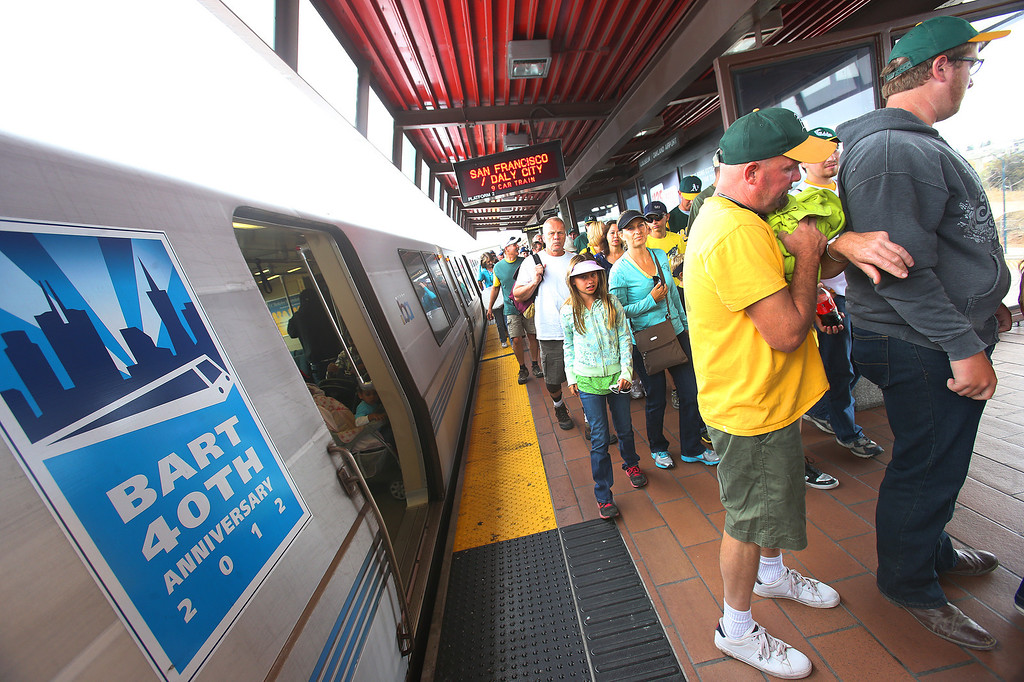 . BART riders exit trains at the Coliseum station on Sunday, Aug. 4, 2013, in Oakland, Calif.  BART management and unions are working on contract negotiations.  (Aric Crabb/Bay Area News Group)