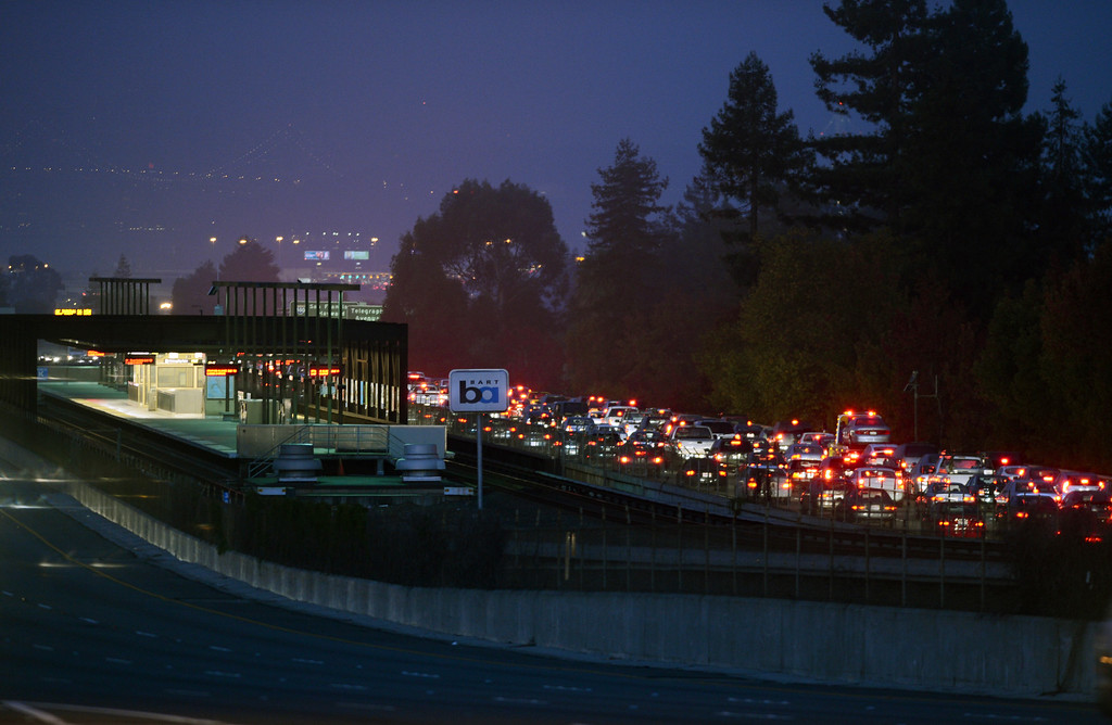 . Brake lights glow in the early morning as traffic slows past the Rockridge BART station as workers at the transit agency go on strike in Oakland, Calif., on Friday, Oct. 18, 2013. (Kristopher Skinner/Bay Area News Group)