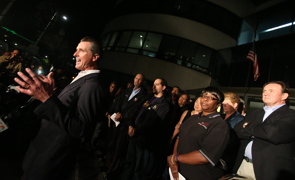 . Lt. Gov. Gavin Newsom, left, speaks to the media about the end to the BART strike outside the Joseph P. Bort MetroCenter on Monday, Oct. 21, 2013, in Oakland, Calif.  (Aric Crabb/Bay Area News Group)