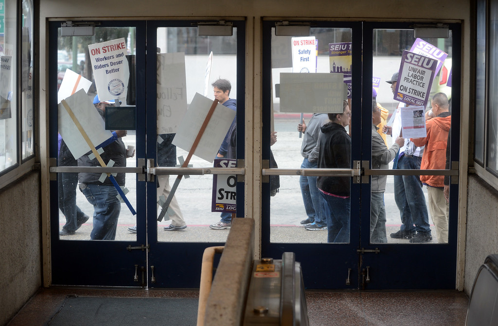 . The entrance to the Lake Merritt BART station is closed off as workers walk the picket line in Oakland, Calif., on Monday, Oct. 21, 2013. (Kristopher Skinner/Bay Area News Group)