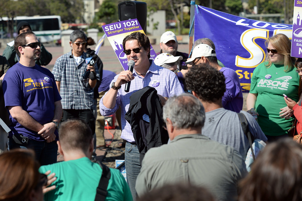 . Pete Castelli, of SEIU 1021 speaks at a noontime rally outside of the Lake Merritt BART station in Oakland, Calif., on Friday, Oct. 18, 2013. BART workers went on strike at midnight after contract talks broke down, forcing commuters to find alternative ways to get to around the Bay Area. (Dan Honda/Bay Area News Group)
