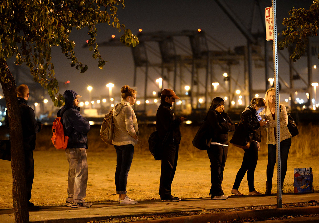 . Commuters wait in line at the Alameda Main Street Ferry Terminal in Alameda, Calif., on Friday, Oct. 18, 2013. BART workers went on strike at midnight after contract talks broke down, forcing commuters to find alternative ways to get to around the Bay Area. (Dan Honda/Bay Area News Group)